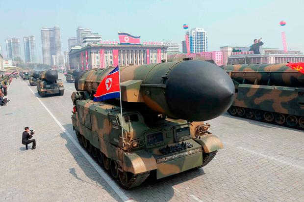 This April 15, 2017 picture released from North Korea's official Korean Central News Agency (KCNA) on April 16, 2017 shows Korean People's ballistic missiles being displayed through Kim Il-Sung square during a military parade in Pyongyang marking the 105th anniversary of the birth of late North Korean leader Kim Il-Sung. / AFP PHOTO / KCNA VIA KNS / STR /