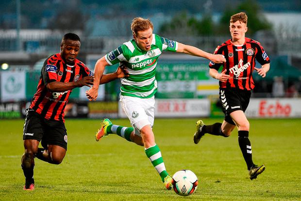 Simon Madden breaks away from Boh's Fuad Sule. Photo: David Maher/Sportsfile