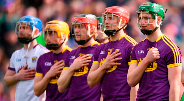Wexford players stand for the national anthem in Nowlan Park on Sunday. Photo: Sportsfile