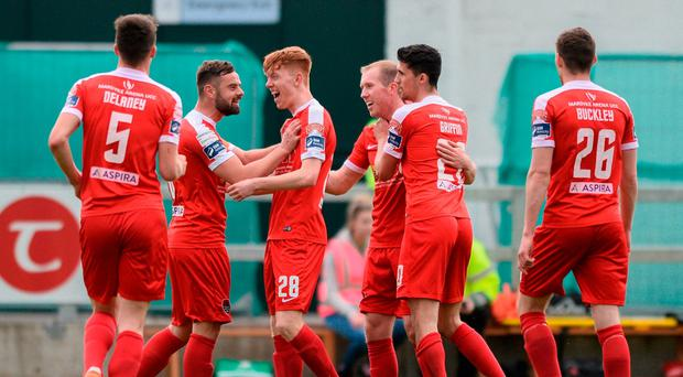 Cork City players including Steven Beattie, Alec Byrne, Stephen Dooley, and Shane Griffin celebrate their side's second goal at The Markets Field in Limerick. Photo: Diarmuid Greene/Sportsfile