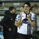 Jamie McGrath (right) scored Dundalk's winning penalty against UCD. Photo: David Maher/Sportsfile