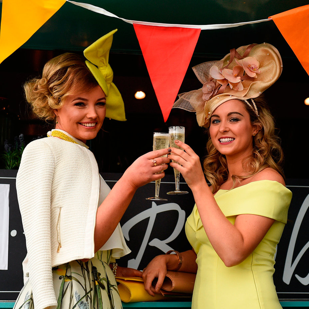 Geraldine Rowland (left) from Curragha, Co Meath, and Suzanne McGovern, from Kilmessan, Co Meath, toast the Grand National winners Picture: Sportsfile