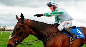 Robbie Power congratulates his horse Our Duke after winning the Boylesports Irish Grand National Steeplechase during the Fairyhouse Easter Festival in Ratoath, Meath. Photo: Sportsfile