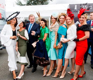 Taoiseach Enda Kenny with some of the entrants in the Most Stylish Lady competition at Fairyhouse yesterday. Photo: Andres Poveda