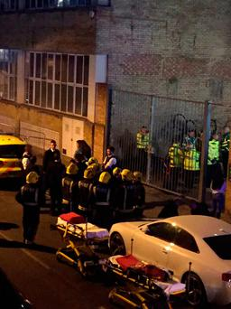 Emergency services at the scene of an incident in Dalston, east London, where at least 12 revellers have suffered burns from a noxious substance at a nightclub. Photo: @PhieMcKenzie/PA Wire