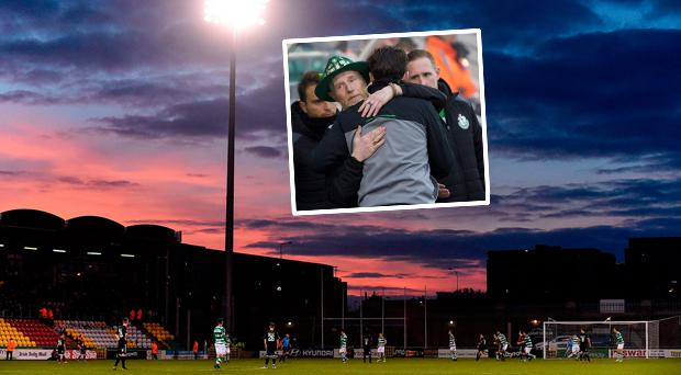 Shamrock Rovers boss Stephen Bradley embraces the father of Stephen Lynch in Tallaght