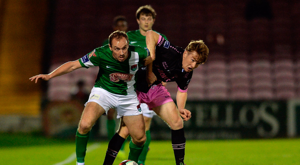 Colin Healy of Cork City in action against Vincent Quinlin of Wexford Youths