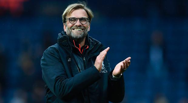 Liverpool's German manager Jurgen Klopp celebrates winning the English Premier League football match between West Bromwich Albion and Liverpool at The Hawthorns stadium in West Bromwich, central England, on April 16, 2017. / JUSTIN TALLIS/AFP/Getty Images