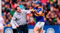 Wexford manager Davy Fitzgerald and Tipp's Jason Forde tangle in Nowlan Park on Sunday Photo: Stephen McCarthy/Sportsfile