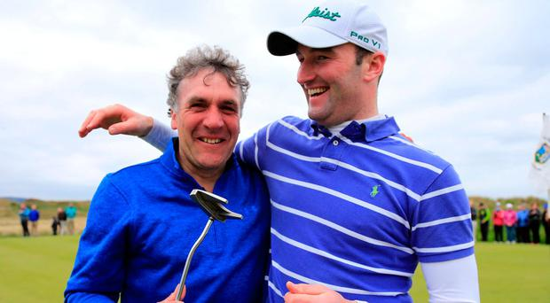 Barry Anderson celebrates his West of Ireland win with father Roy. Photo: Fran Caffrey/Golffile
