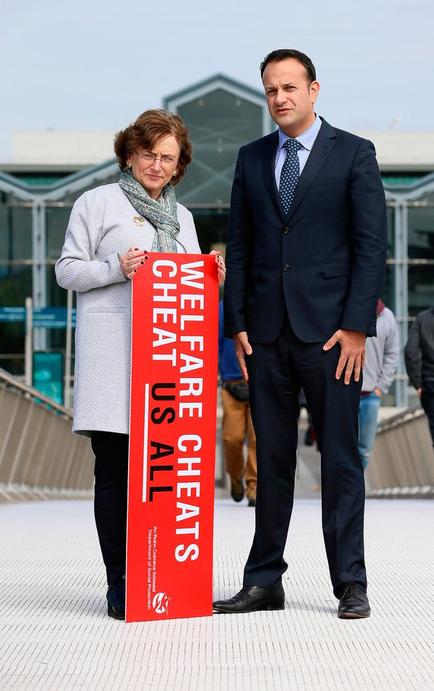 Minister Leo Varadkar and Kathleen Stack from the Department of Social Protection at the launch of the welfare fraud campaign. Photo: Frank McGrath