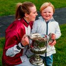 Áine O'Connor celebrates her victory on Coldstonesober in the Today FM Ladies Grand National with her nephew Oisín O'Connor. Photo: Cody Glenn/Sportsfile
