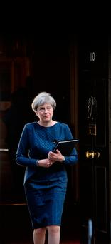 British Prime Minister Theresa May prepares to make a statement in Downing Street yesterday Picture: John Stillwell/PA Wire