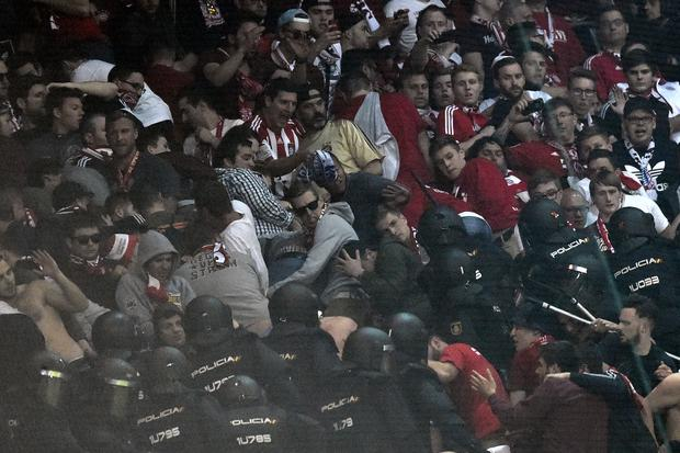 Riot police clash with Bayern fans in the tribunes during the UEFA Champions League quarter-final second leg football match Real Madrid vs FC Bayern Munich at the Santiago Bernabeu stadium in Madrid in Madrid