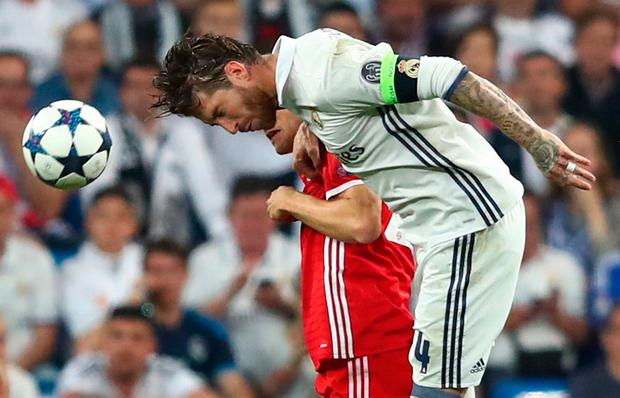 Real Madrid's Sergio Ramos gets his head to the ball Photo: Reuters / Michael Dalder