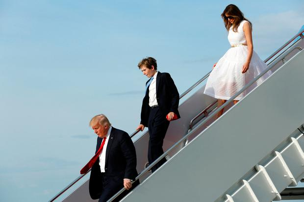 U.S. President Donald Trump with First Lady Melania Trump and their son Barron arrive at Joint Base Andrews outside Washington, U.S., after Easter weekend in Palm Beach, Florida, April 16, 2017. REUTERS/Yuri Gripas
