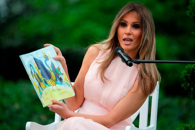 U.S. first lady Melania Trump reads 'Party Animals' by Kathy Lee Gifford during the 139th Easter Egg Roll on the South Lawn of the White House