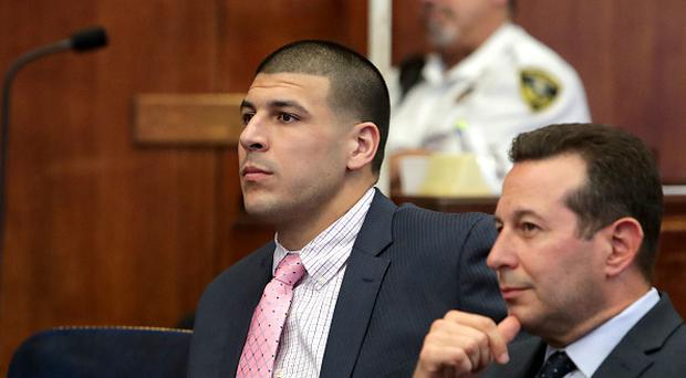 BOSTON - OCTOBER 5: Aaron Hernandez sits at a hearing on the murder charges against him at Suffolk Superior Court in Boston on Oct. 5, 2016. Hernandez is a former NFL player for the New England Patriots. (Photo by John Blanding/The Boston Globe via Getty Images)