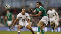 Ireland's full-back Jared Payne (R) passes the ball by England's Jonathan Joseph during the Six Nations international rugby union match between Ireland and England at the Aviva Stadium in Dublin on March 18, 2017. / AFP PHOTO / Adrian DENNIS (Photo credit should read ADRIAN DENNIS/AFP/Getty Images)
