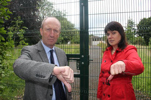 Shane Ross pictured alongside his constituency colleague Deirdre Donnelly at the gate of the site