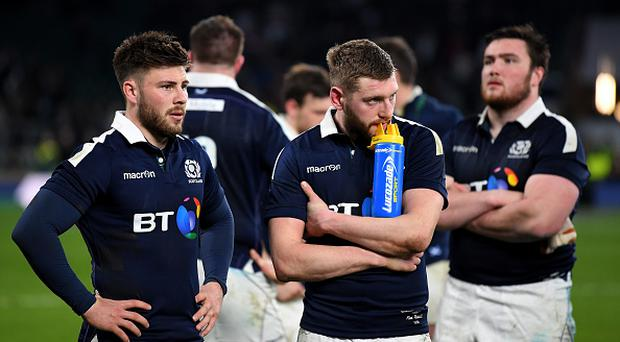 LONDON, ENGLAND - MARCH 11: Scotland players look dejected after the RBS Six Nations match between England and Scotland at Twickenham Stadium on March 11, 2017 in London, England. (Photo by Laurence Griffiths/Getty Images)
