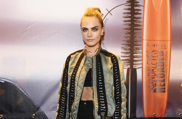 LCara Delevingne poses as she and Rimmel celebrate their new partnership and launch the new Scandaleyes Reloaded Mascara with a party at Kachette on November 9, 2016 in London, England.