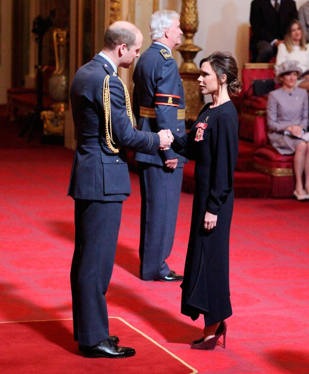 Victoria Beckham receives her OBE from the Duke of Cambridge during an investiture ceremony at Buckingham Palace in London. Pic: Yui Mok/PA Wire