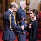Victoria Beckham collects her OBE from Prince William today. Yui Mok/PA Wire