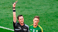 Referee Paddy Neilan shows a black card to Jonathan Lyne of Kerry, who lead the way as the worst black card offenders. Photo by Ray McManus/Sportsfile