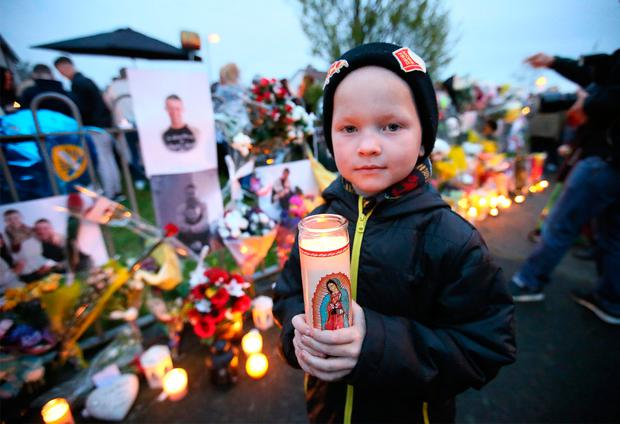 Six year old Ralph Vaitkus, pictured at the vigil for Stephen Lynch at Glenshane Close. Picture Credit:Frank Mc Grath