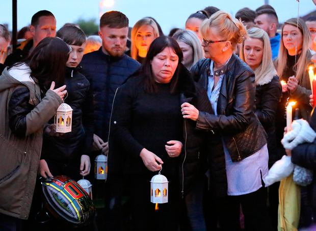 Family and friends pictured at the vigil for Stephen Lynch at Glenshane Close. Picture: Frank Mc Grath