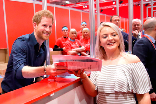 Prince Harry helps hand out race numbers and headbands as he officially opens this year's Virgin Money London Marathon Expo Picture: PA/Getty