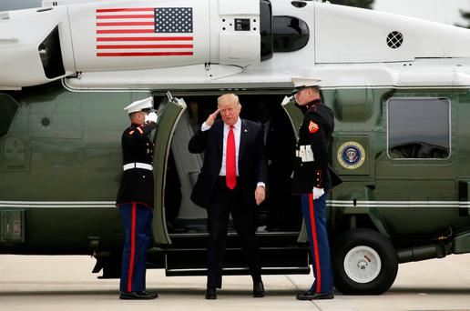 US President Donald Trump returns a salute as he steps from Marine One to board Air Force One as he departs Milwaukee, Wisconsin. Photo: Reuters/Kevin Lamarque.