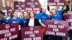 Joanne Irwin (centre) at a protest against pay inequality. Photo: Tony Gavin