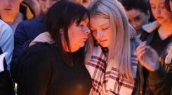 Family and friends at the vigil for Stephen Lynch at Glenshane Close Photo: Frank McGrath
