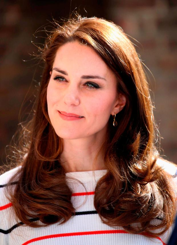 Britain's Catherine, Duchess of Cambridge speaks with runners from Team Heads Together ahead of the 2017 Virgin Money London Marathon, at Kensington Palace on April 19, 2017 in London