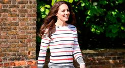 Britain's Catherine, Duchess of Cambridge hosts a reception for runners from Team Heads Together ahead of the 2017 Virgin Money London Marathon, at Kensington Palace on April 19, 2017 in London