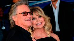 Actor Kurt Russell and actress Goldie Hawn arrive for the world premiere of the film