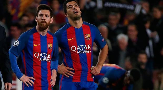 Barcelona's Lionel Messi and Luis Suarez look dejected after the match