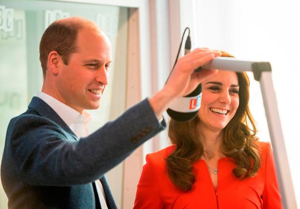 Britain's Prince William, Duke of Cambridge and Britain's Catherine, Duchess of Cambridge tour a radio studo during the official opening of the Global Academy in Hayes, London on April 20, 2017, in support of the Heads Together campaign. / AFP PHOTO / POOL / Dominic LipinskiDOMINIC LIPINSKI/AFP/Getty Images