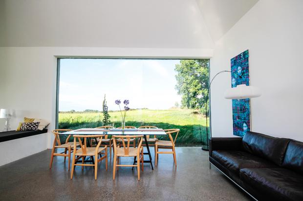 Louise McGuane and Dominic McCarthy's Co Clare Home: Judge Declan O'Donnell was thrilled with the frameless picture window in the Co. Clare cottage. Photo credit: RTE