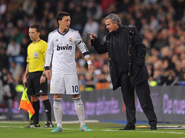 Ozil and Mourinho together at Madrid in 2012. Getty