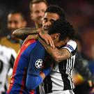 Dani Alves comforted his former team-mate Neymar after the final whistle. Getty