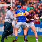 Wexford manager Davy Fitzgerald with Jason Forde of Tipperary and Aidan Nolan of Wexford during the Allianz Hurling League Division 1 Semi-Final match between Wexford and Tipperary at Nowlan Park in Kilkenny. Photo by Stephen McCarthy/Sportsfile