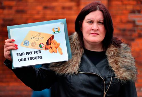 Emma Magee, of the WPDF, protesting outside McKee Barracks. Photo: Niall Carson/PA Wire