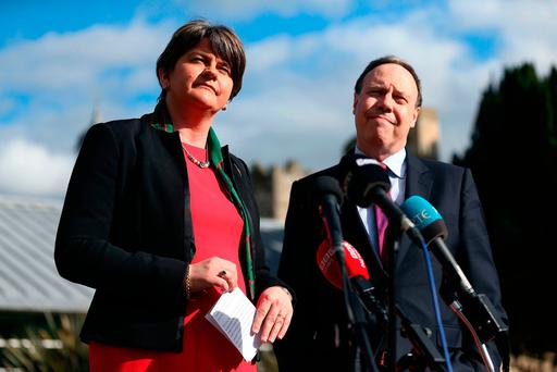 DUP leader Arlene Foster and deputy leader Nigel Dodds speak to the media on the grounds of Stormont Castle. Photo: PA