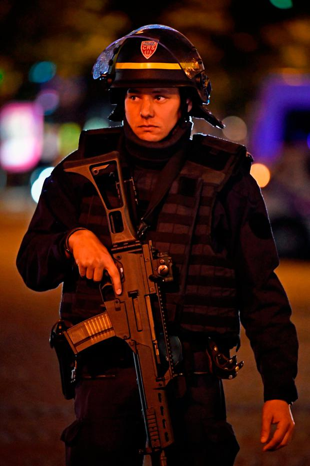 Police officers secure the area after a gunman opened fire on the Champs Elysees. Photo: GETTY