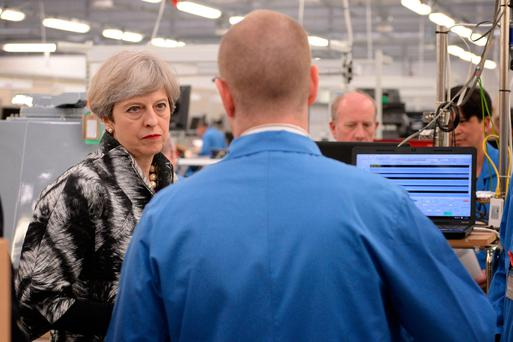 Britain's Prime Minister Theresa May visits radar manufacturer Kelvin Hughes Limited in Enfield, north London, yesterday. Photo: Reuters