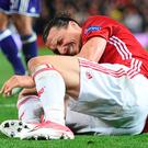 Manchester United's Zlatan Ibrahimovic reacts after falling awkwardly in Manchester United's Europa League quarter-final against Anderlecht on Thursday. Photo: Oli Scarff/Getty Imges