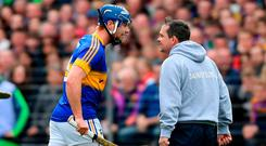Wexford manager Davy Fitzgerald tussles with Tipperary's Jason Forde. Photo: Ramsey Cardy/Sportsfile